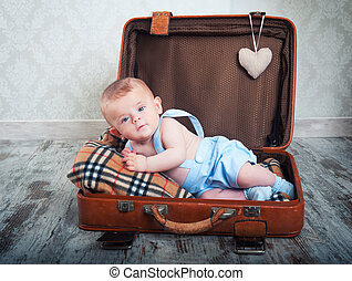 little boy - beautiful little boy in the old days a suitcase