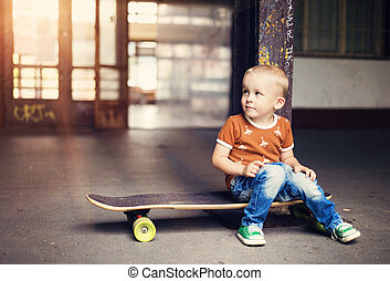 Little boy - Cute little boy with his skateboard on a walk...