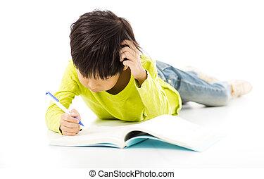 Little boy study on the floor
