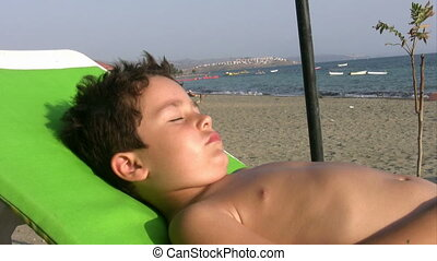 Little boy sunbathing