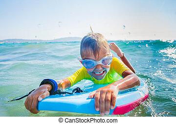Little boy surfboarding