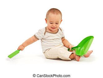 Little boy sweeping
