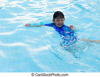 little boy swimming in the pool