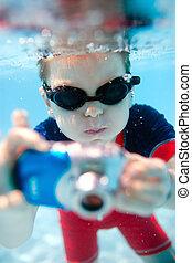 Little boy swimming underwater - Cute little boy swimming...