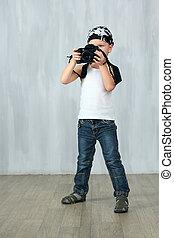 Little boy takes a photo