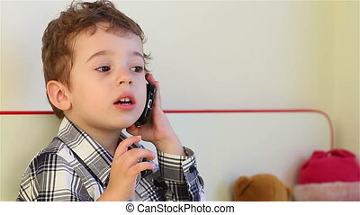 Little boy talking on smartphone - Smiling little boy...