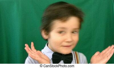 Little boy talking to a camera
