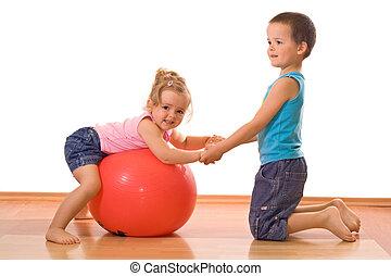 Little boy teaching her sister gymnastics - Little firl and...