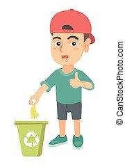 Little boy throwing banana peel in recycling bin.