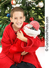 Little Boy Under Christmas Tree with Stocking