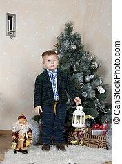 little boy under the tree