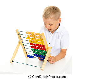 Little boy uses abacus to solve mathematical problems.