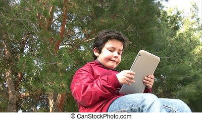 Little boy  using a digital tablet