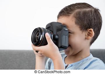Little boy using camera.