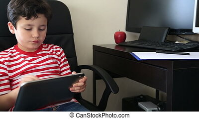 little boy using digital tablet