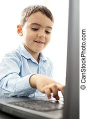 little boy using laptop