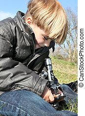 Little boy using microscope