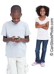 Little boy using mobile phone