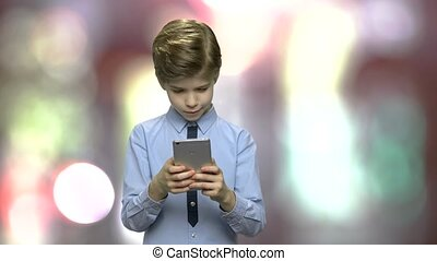 Little boy using smartphone.