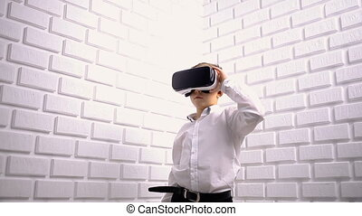 Little boy using virtual reality device