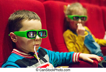 Little boy watching movie in 3d glasses.