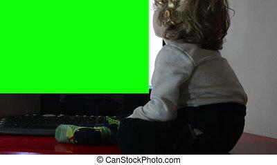 Little boy watching TV,green screen
