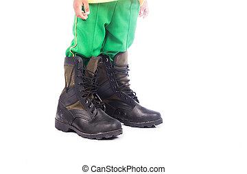 little boy wearing big shoe