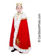 Little boy wearing costume of a king