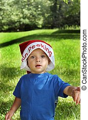 Little boy wearing Santa hat