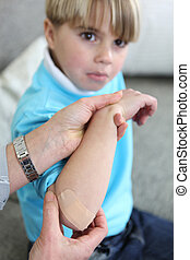 Little boy with a bandage on arm