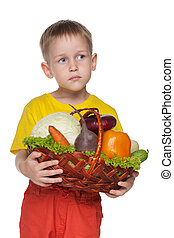 Little boy with a basket with vegetables