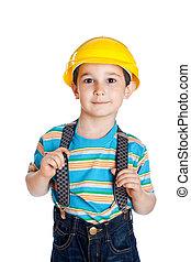 little boy with a building helmet on a head