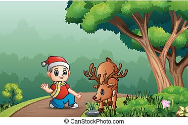 Little boy with a deer in the forest