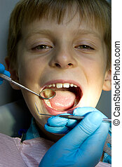little boy with a doctor in dental surgery - Shot of a...