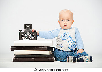 little boy with a film camera