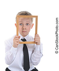 little boy with a frame in his hands.