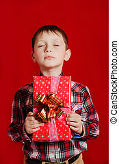 Little boy with a gift box