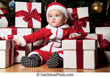 Little boy with a gift boxes.