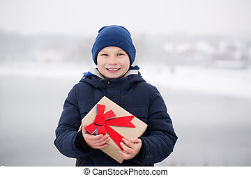 boy with a gift in his hands