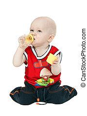 little boy with a pacifier, bottle