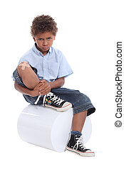 Little boy with a plaster on his knee