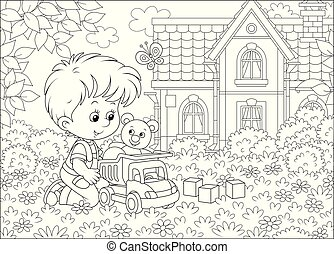 Little boy with a toy truck on a lawn