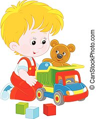 Little boy with a toy truck