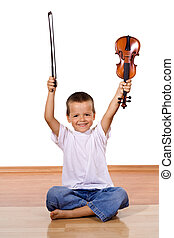 Happy little boy with a violin - isolated