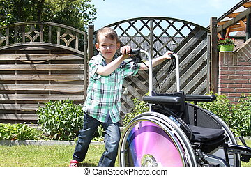 little boy with a wheelchair
