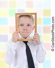 little boy with a wooden frame