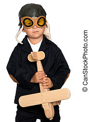 Little boy with a wooden plane.