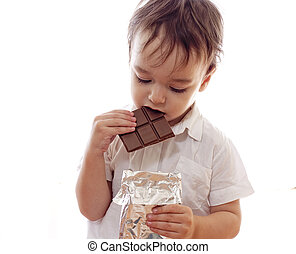 Little boy with bar of chocolate in his hands isolated
