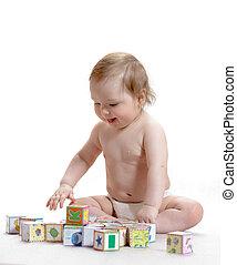 Little boy with blocks on white background