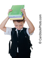 Little boy with books on head